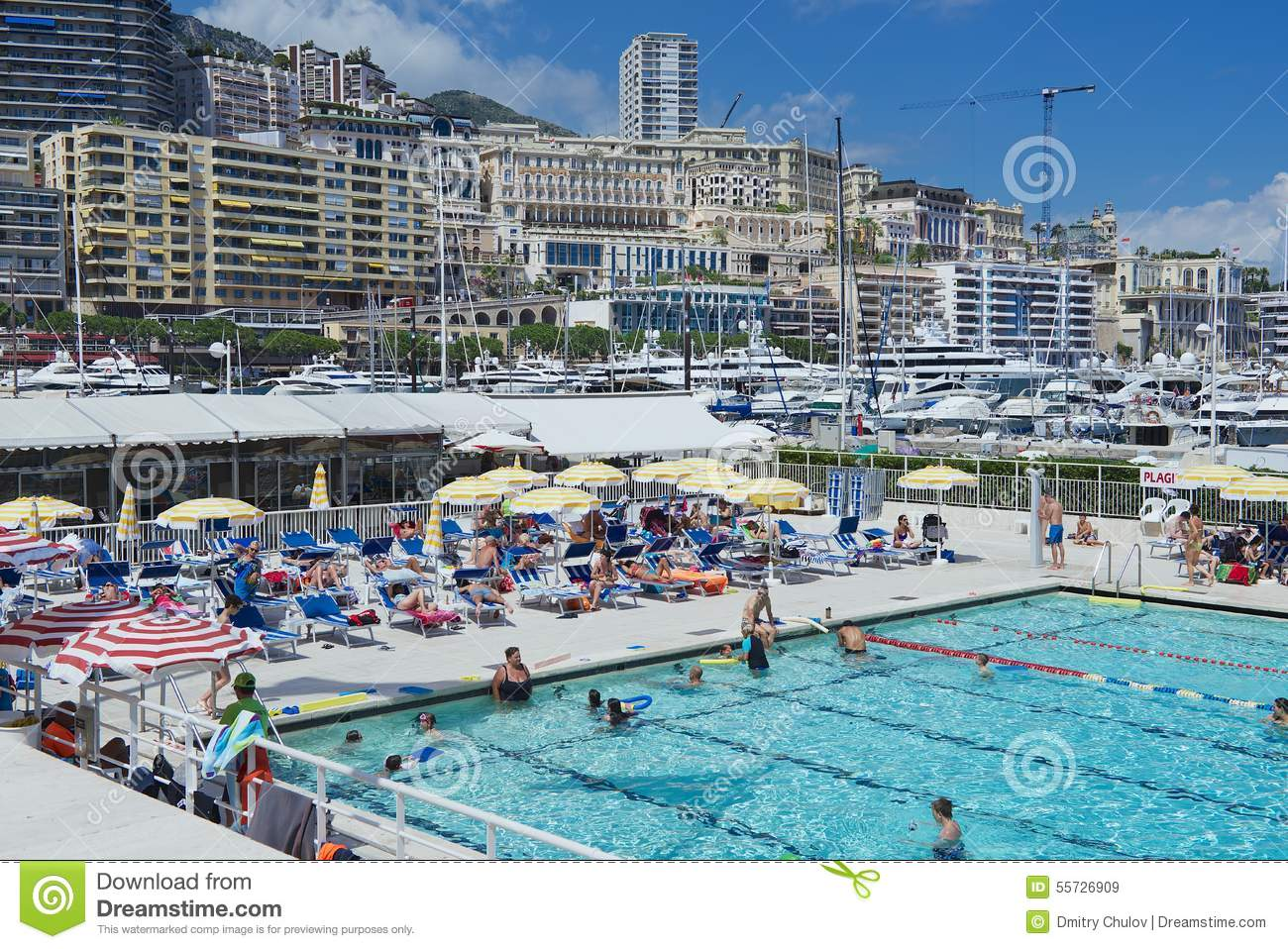 People Swim And Sunbathe At The Open Air Public Swimming Pool In Monaco Editorial Stock Image