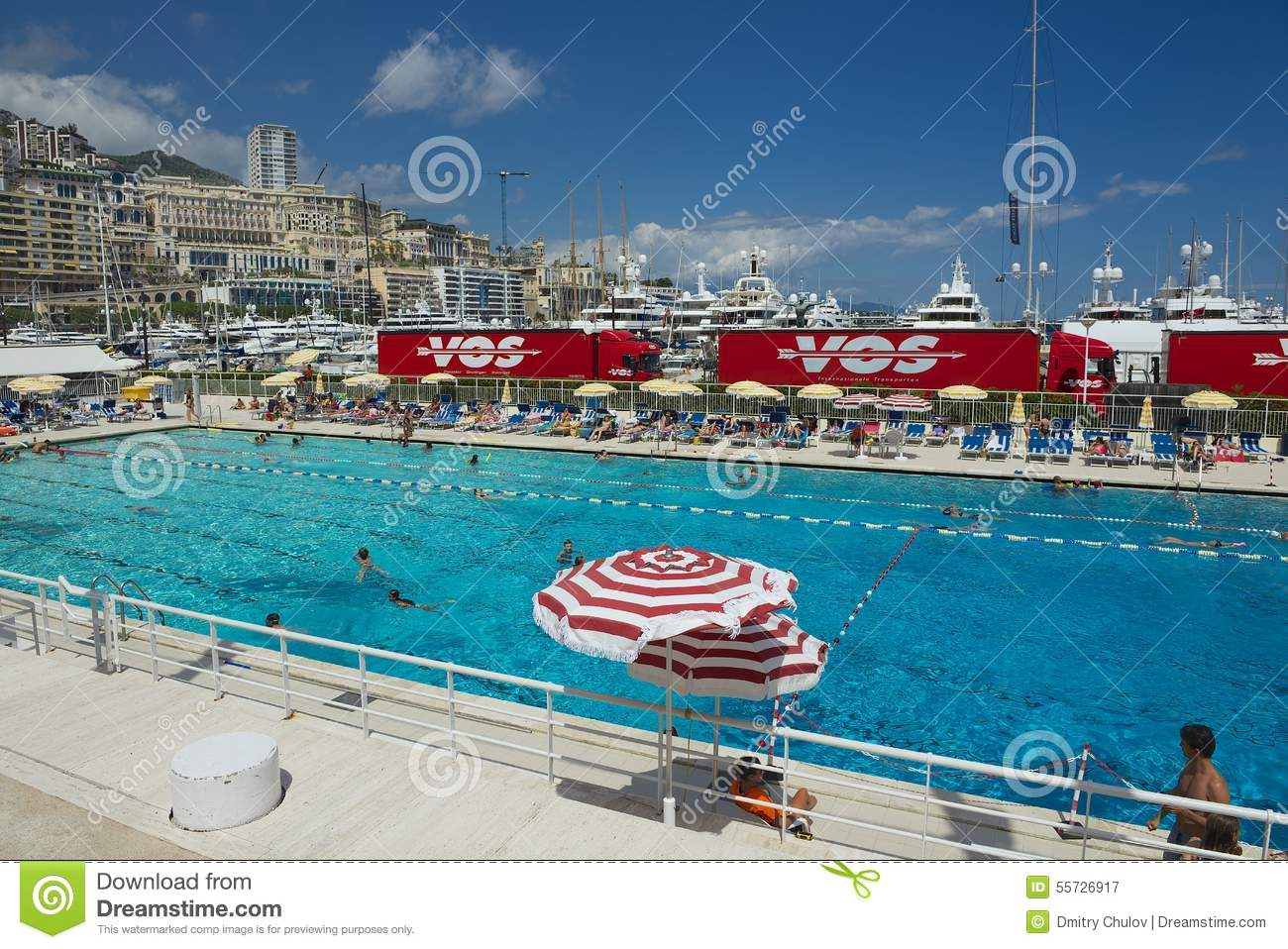 People Swim And Sunbathe At The Open Air Public Swimming Pool In