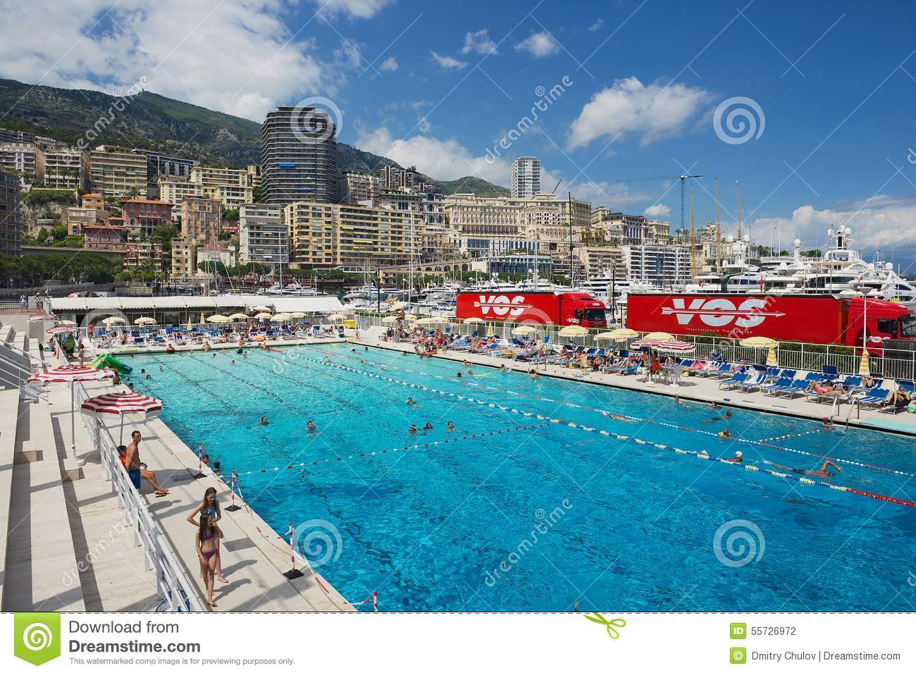 People Swim And Sunbathe At The Open Air Public Swimming Pool In Monaco Editorial Photography