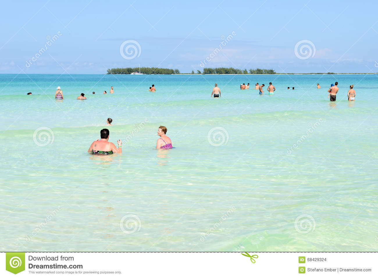 beach with people swimming. editorial stock photo download people swimming beach with