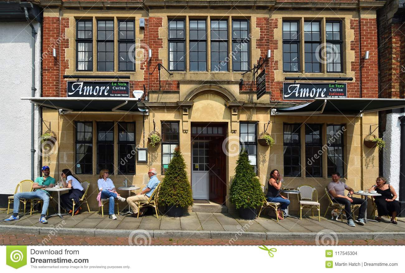 People At Tables Outside Restaurants In The Sunshine Editorial