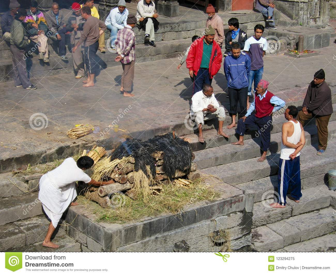 People take part in traditional cremation ceremony at the Pashupatinath temple on the Bagmati River bank in Kathmandu, Nepal.