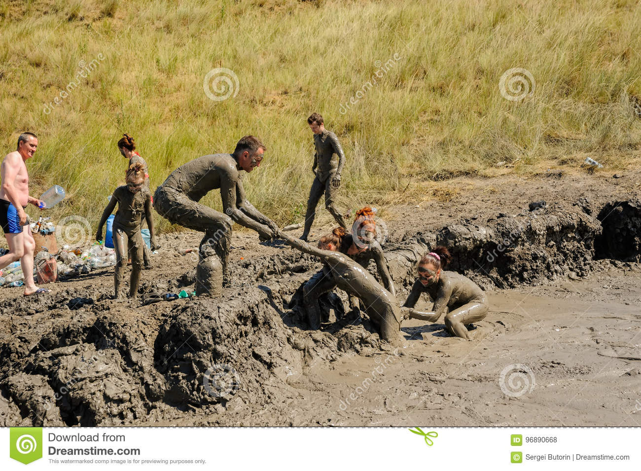 People take procedures with healing mud. Russia