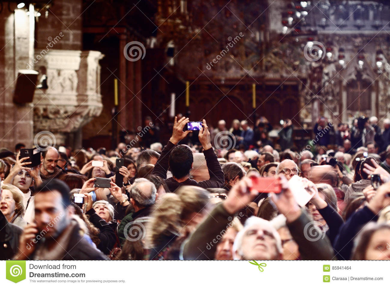 People taking pictures in the spectacle of cathedral of Palma de Majorca.