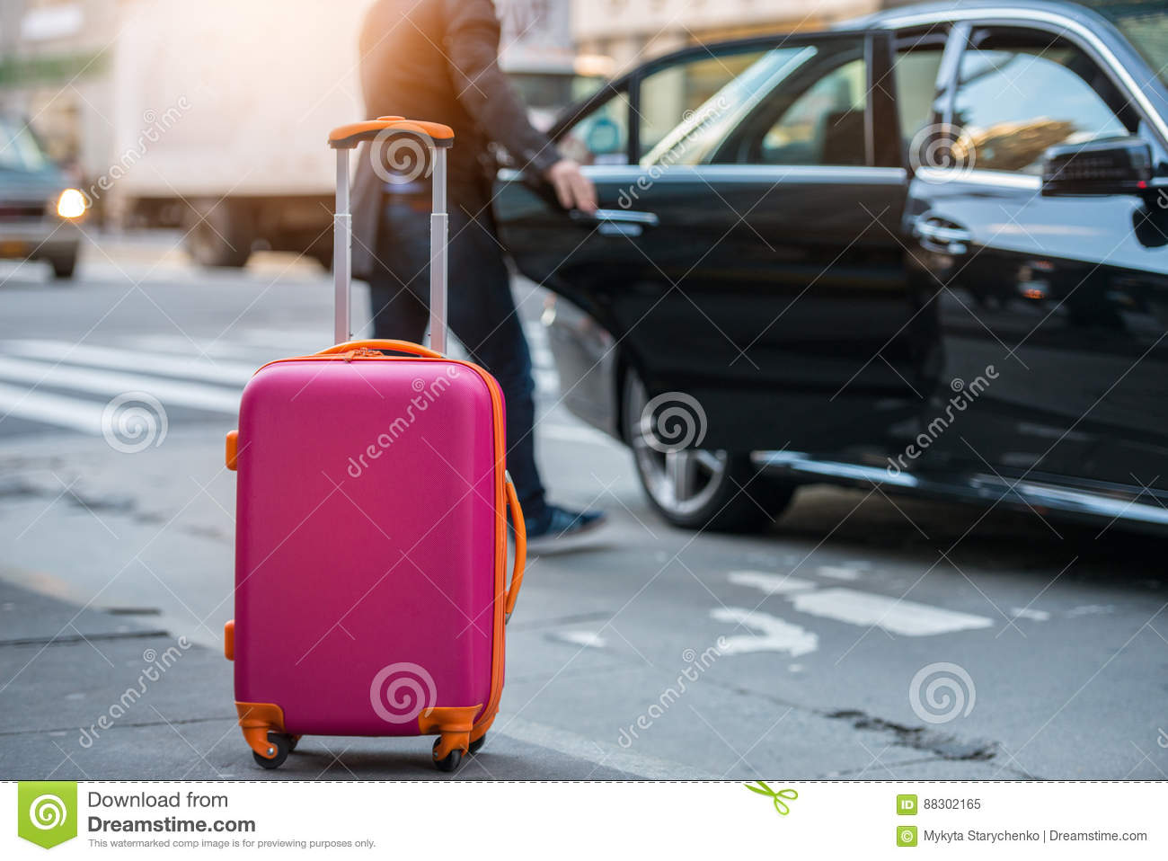 People Taking Taxi From An Airport And Loading Carry On