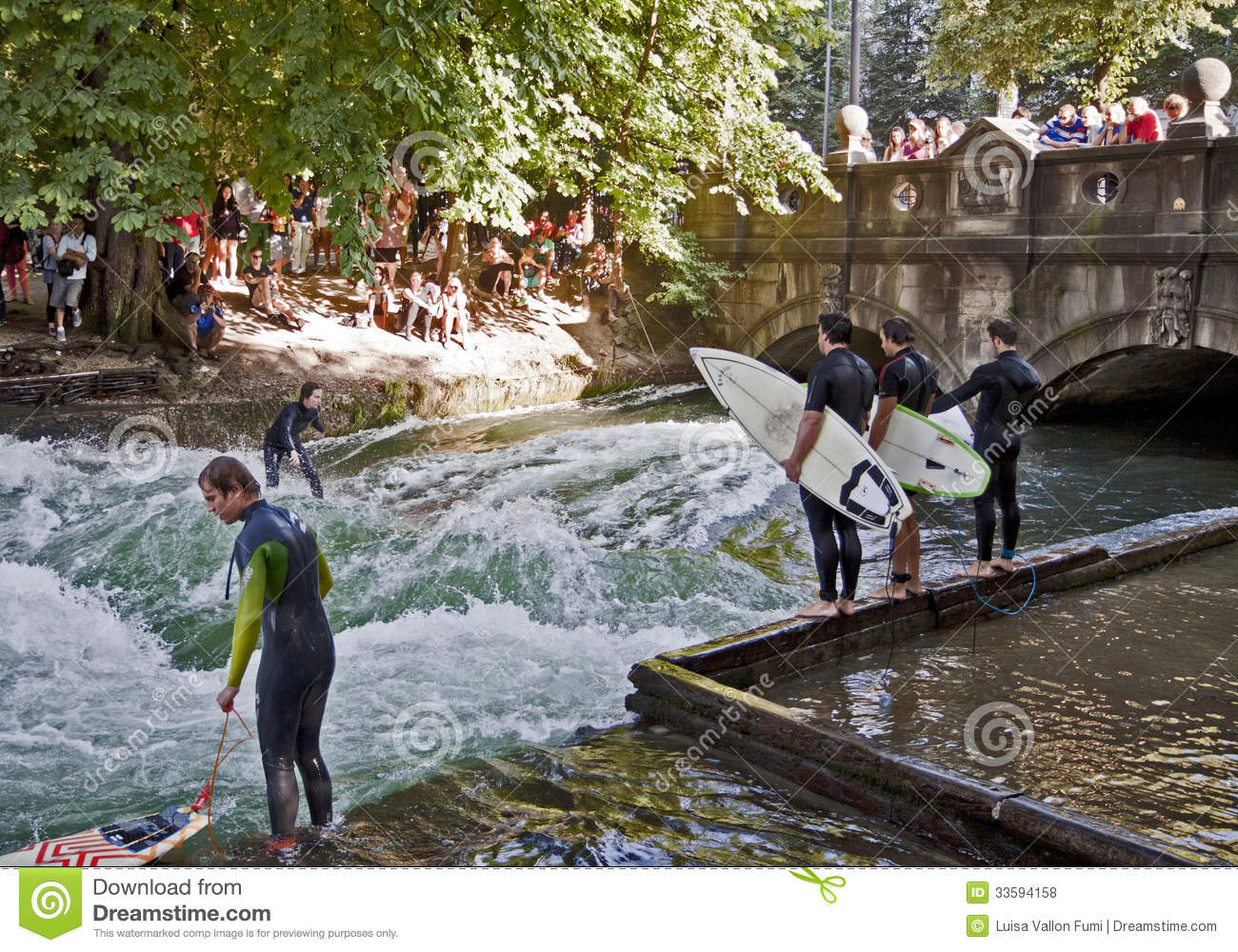 people and tourists watching surfers in center munich. Black Bedroom Furniture Sets. Home Design Ideas