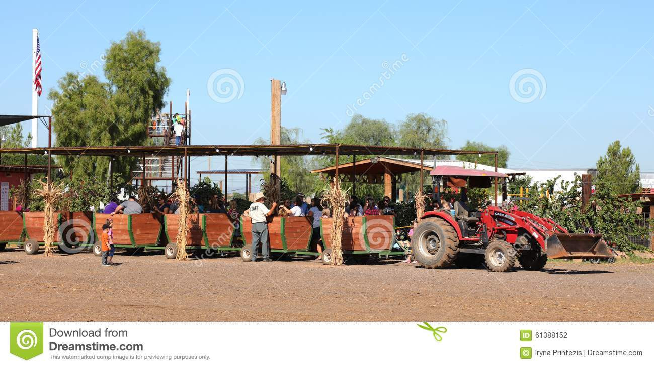 Tractor Train Rides : People on a tractor train ride editorial photography