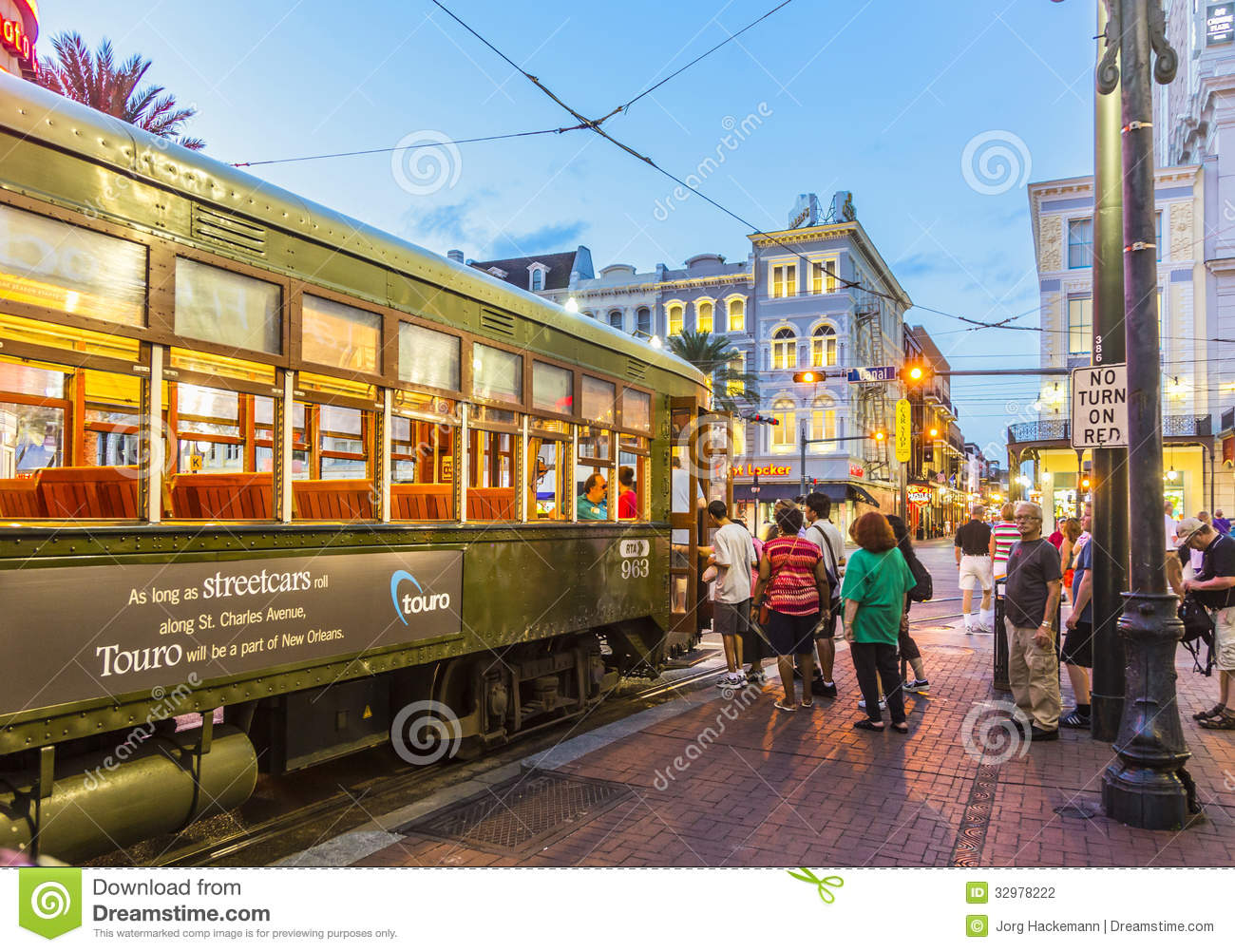 New Orleans Street Cars: People Travel With The Famous Old Streetcar Editorial
