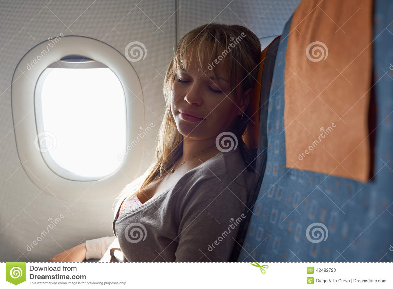 People Travelling Relaxed Woman Sleeping On Plane Stock