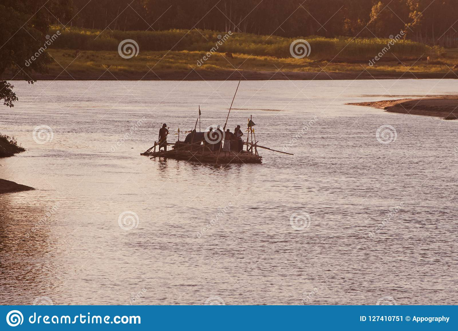 People travelling on a traditional boat in Bangladesh