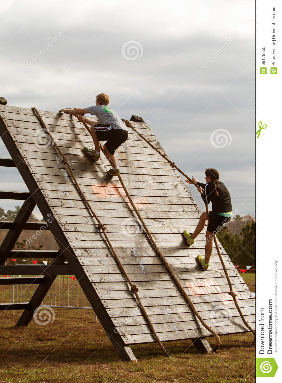 People use ropes to climb wall in extreme obstacle race for How to make a rope wall