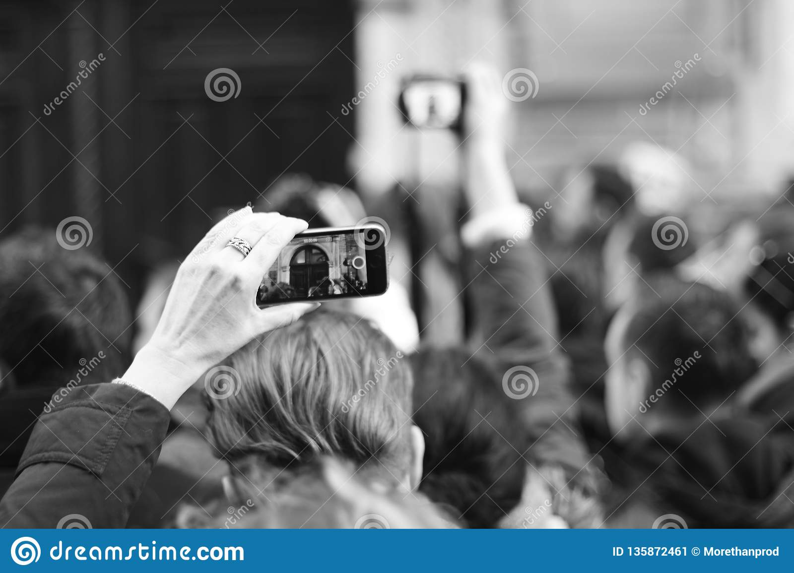 People are waiting for a star. The crowd shoots a star on the phone. Paparazzi everywhere. Journalists are waiting for a star
