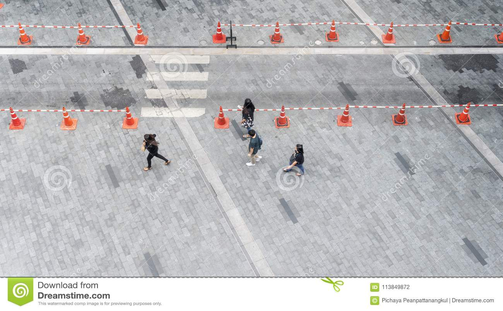 People walk on the pedestrian city street walkway on pavement co