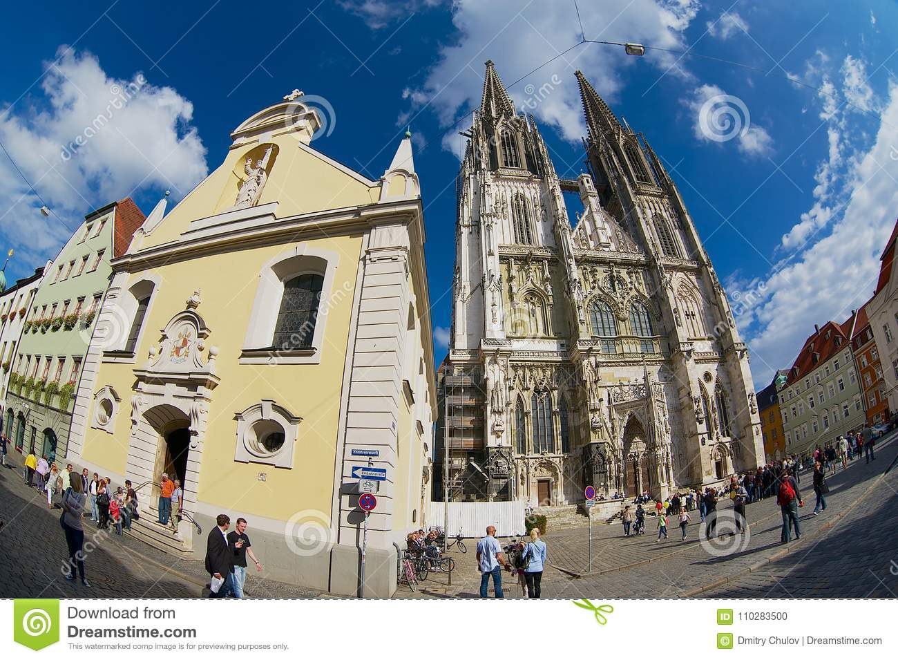 People walk by the street of the historical part of Regensburg, Germany.