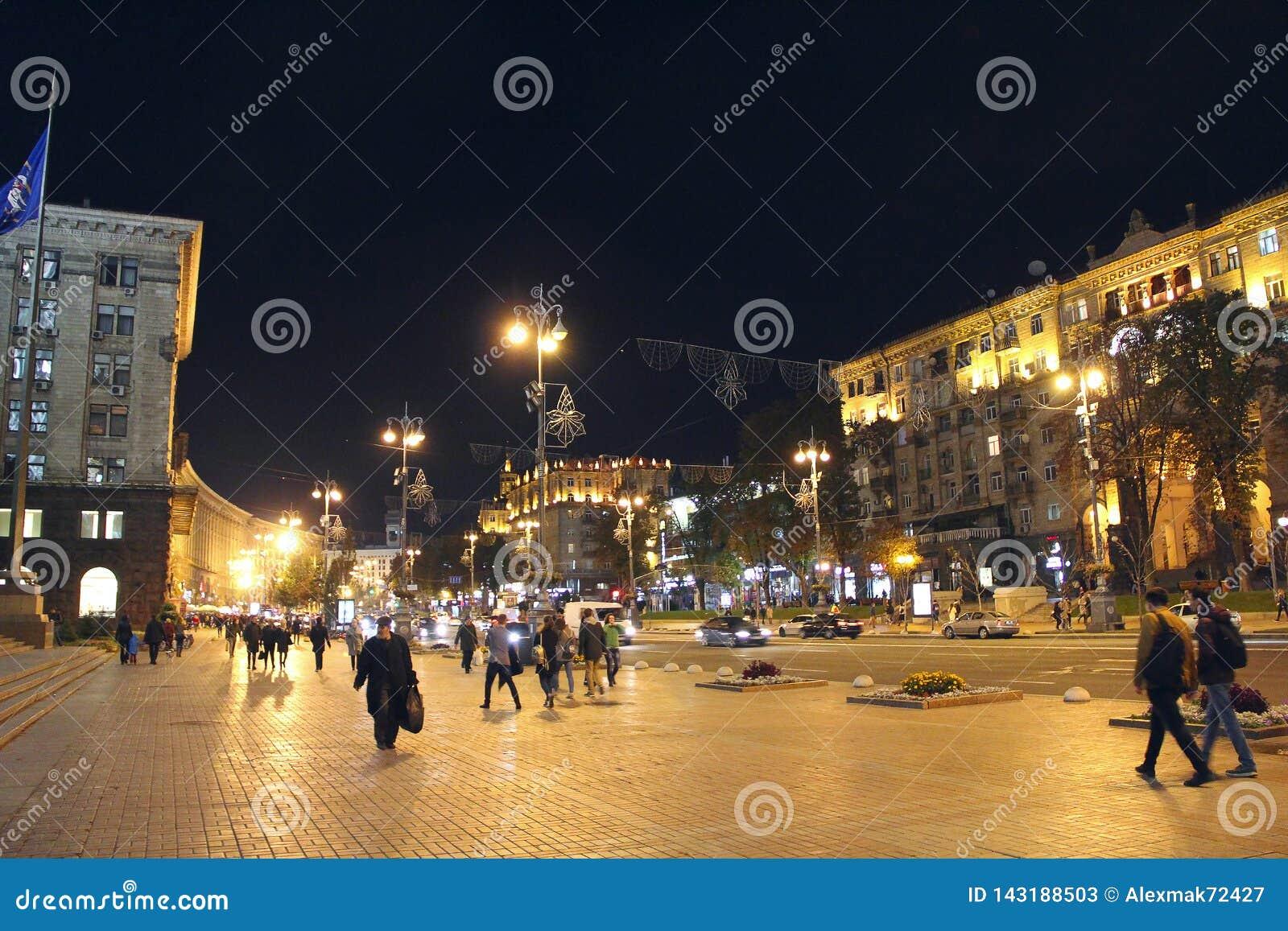 People walk on street Khreshchatyk. Main street of Ukraine in evening