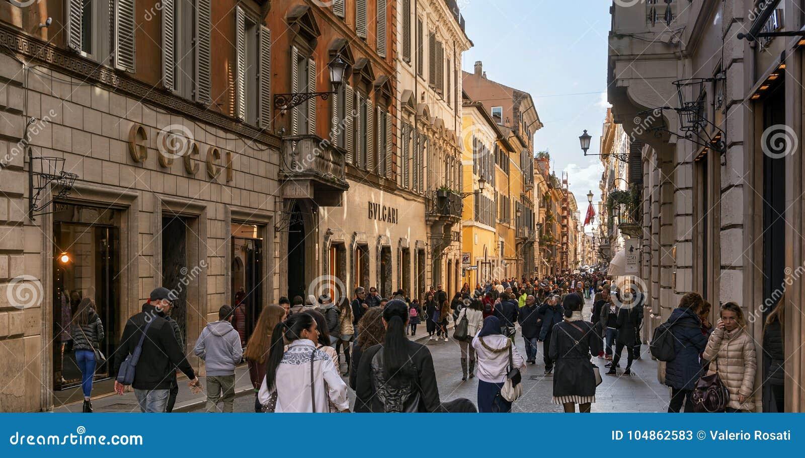 people walking along the elegant shopping avenue Via di Condotti in Rome d1af51f322a