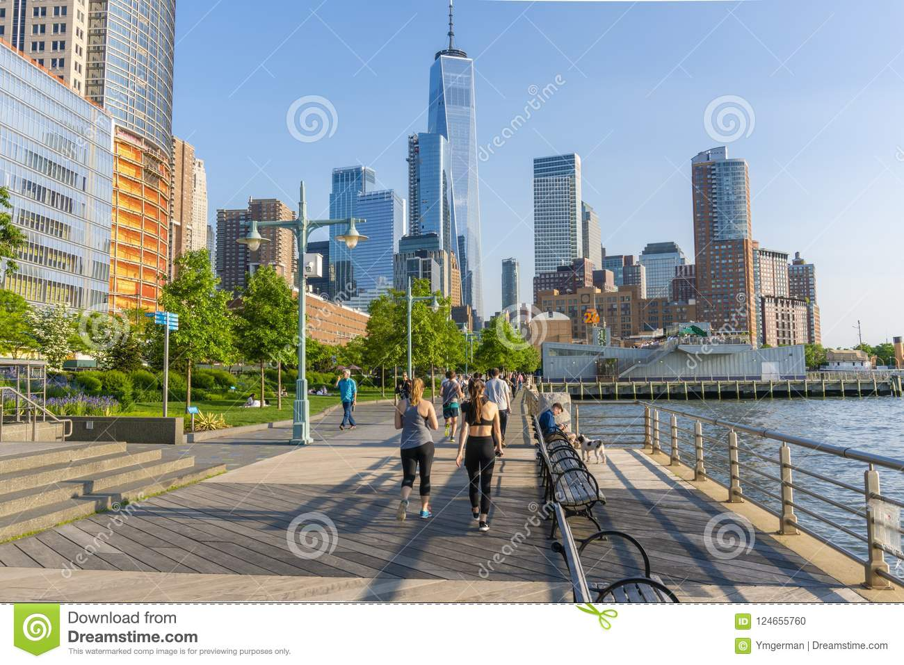 People Walking And Jogging Along The Promenade In New York City