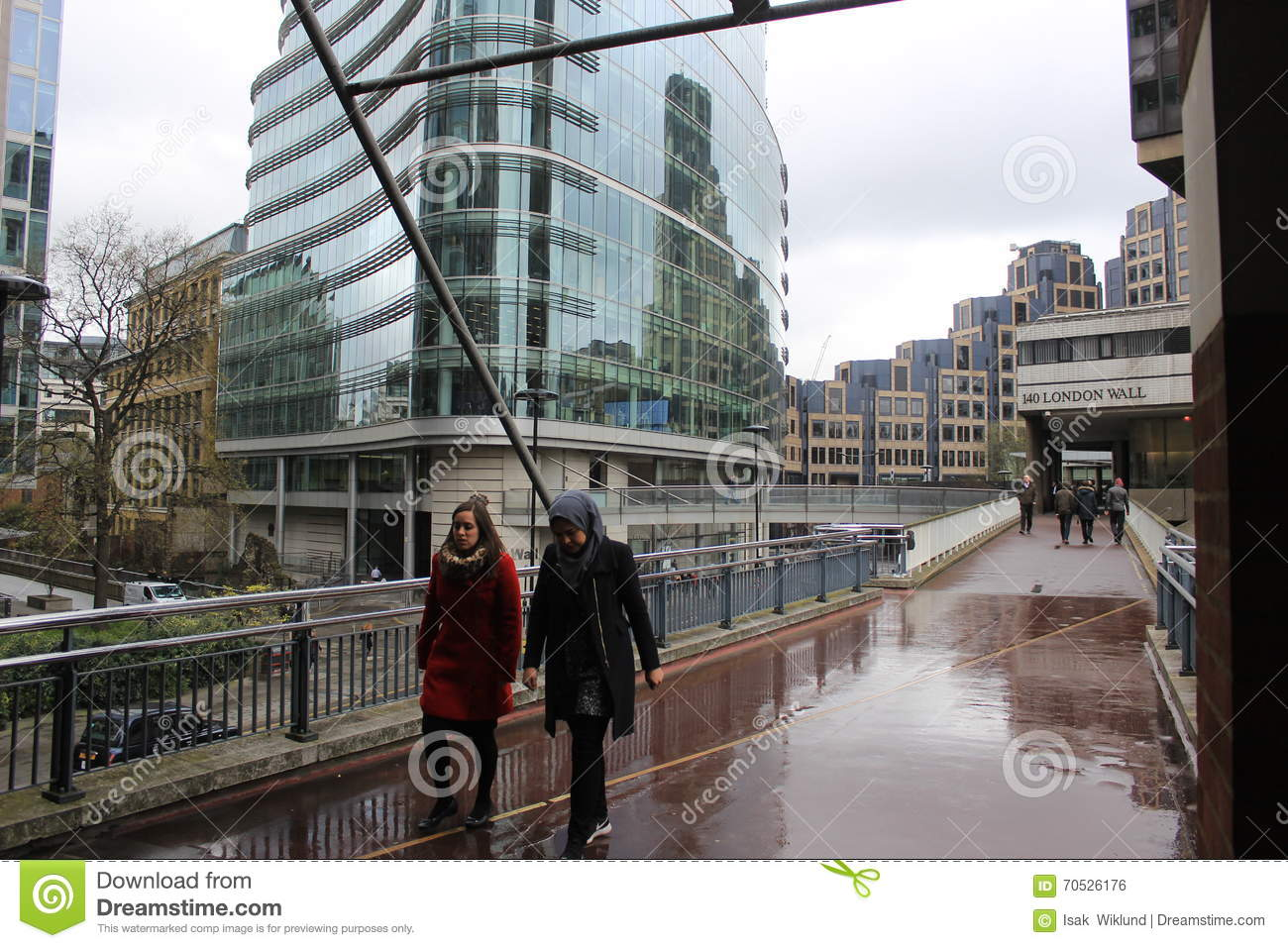 Modern Architecture London England people walking at london wall, england, urban street scene with