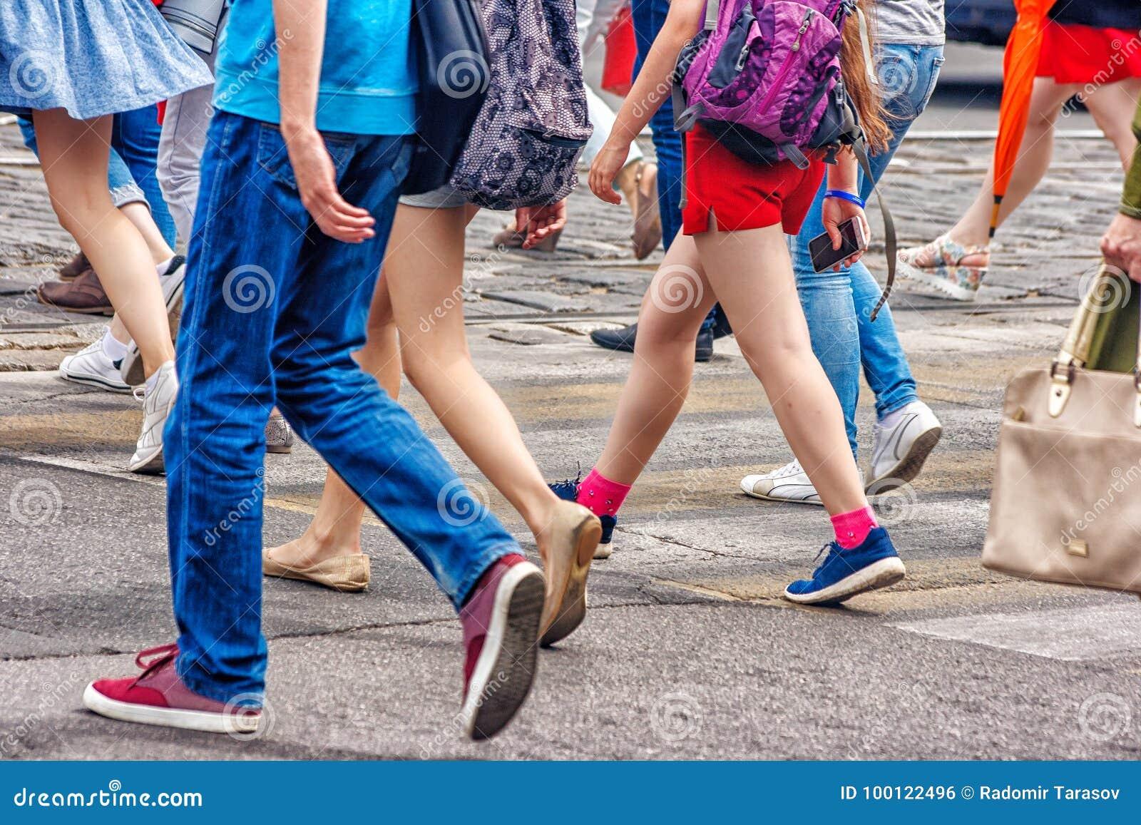 People walking on a pedestrian crossing