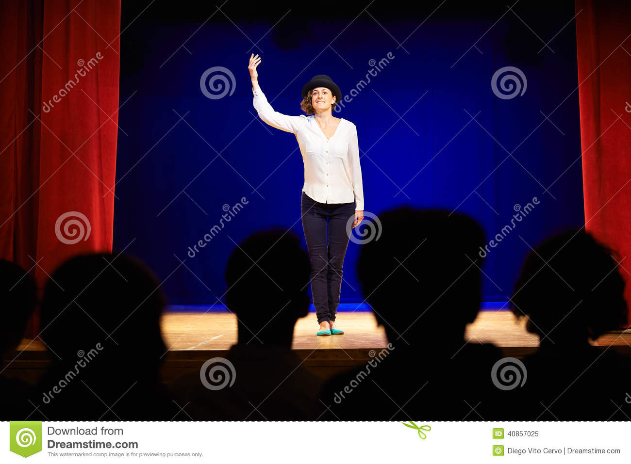 Arts and entertainment in theatre with actress on stage acting in play