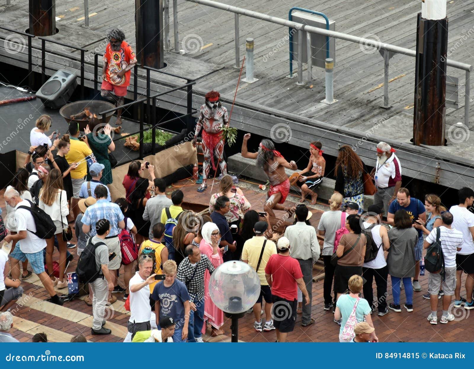 People watching indigenous aboriginal people`s performance