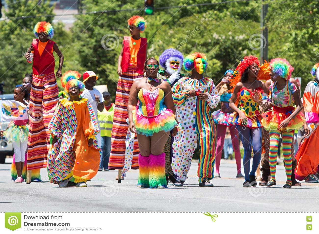 Caribbean People: People Wearing Clown Costumes Walk In Caribbean Culture
