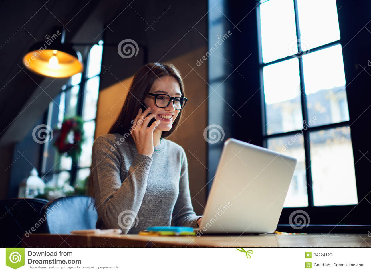 People At Work Talking On Phone With Friend Greeting Stock Photo