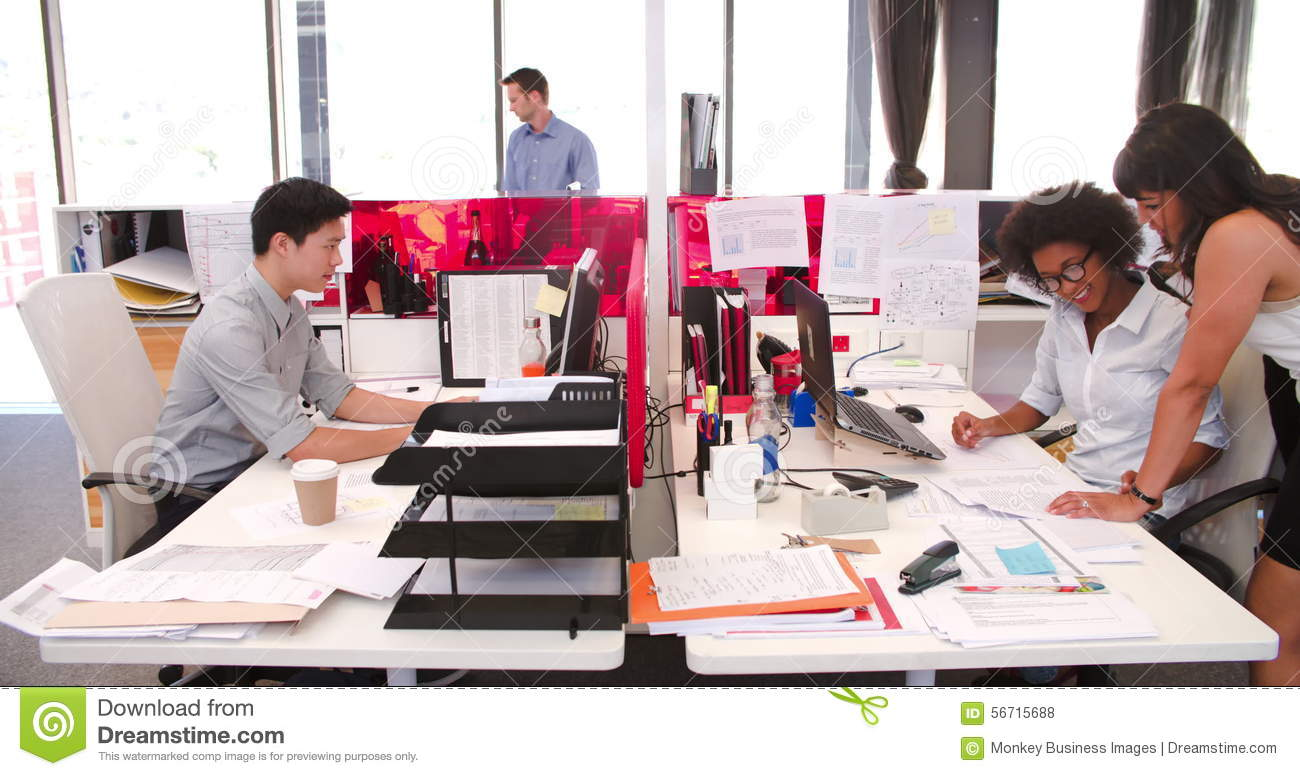people working at desks in modern open plan office stock footage