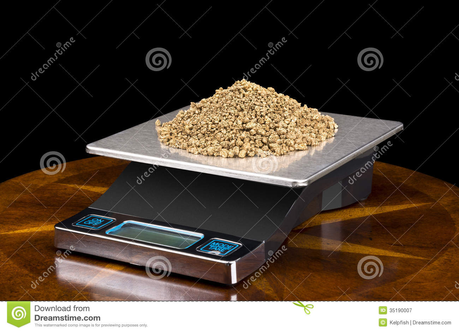 Pepitas de ouro na escala