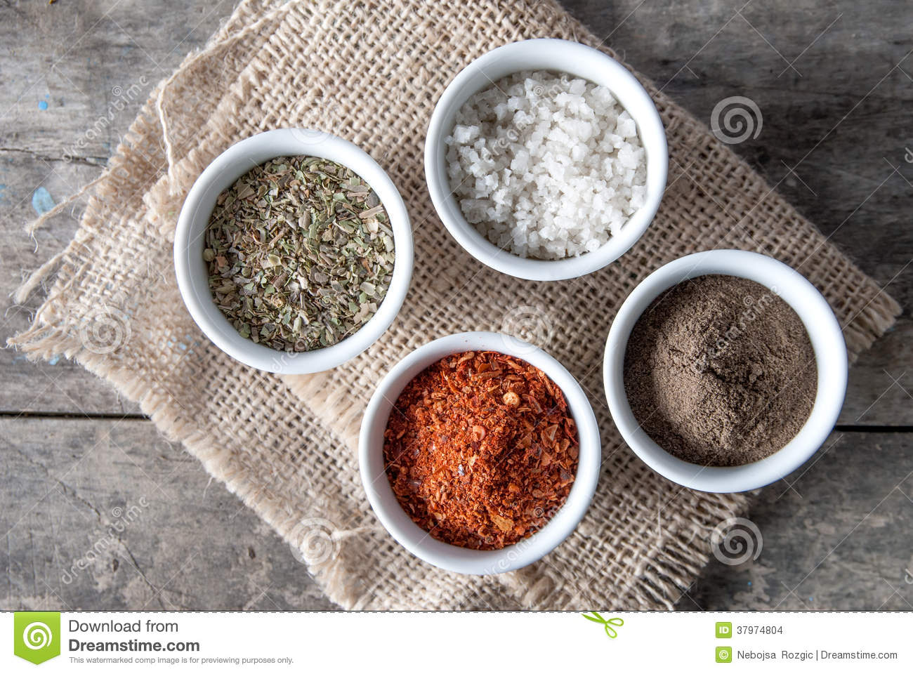 Pepper, Oregano And Cooking Salt In Bowls