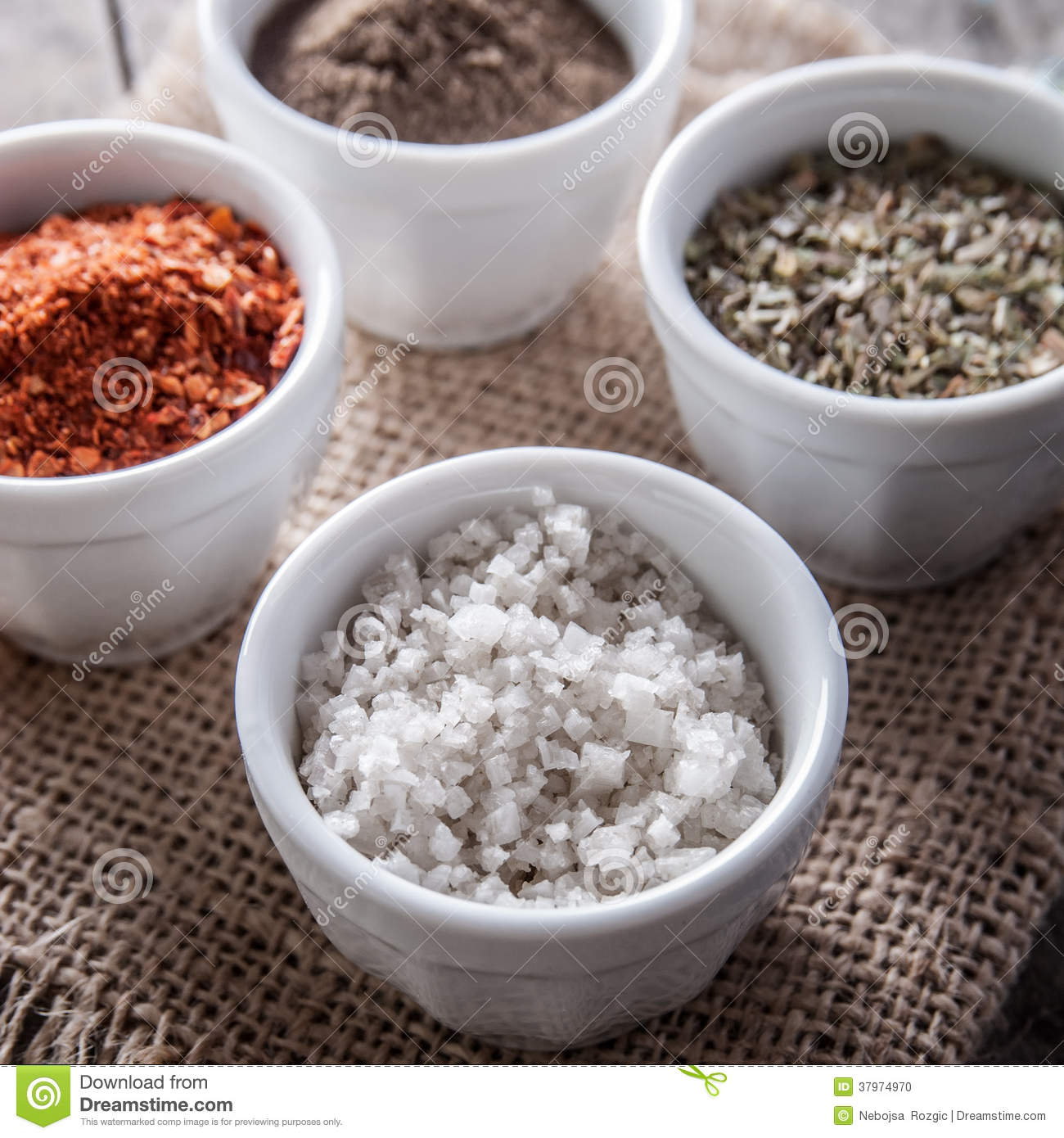 Pepper, Oregano And Cooking Salt In Bowls Stock Photo
