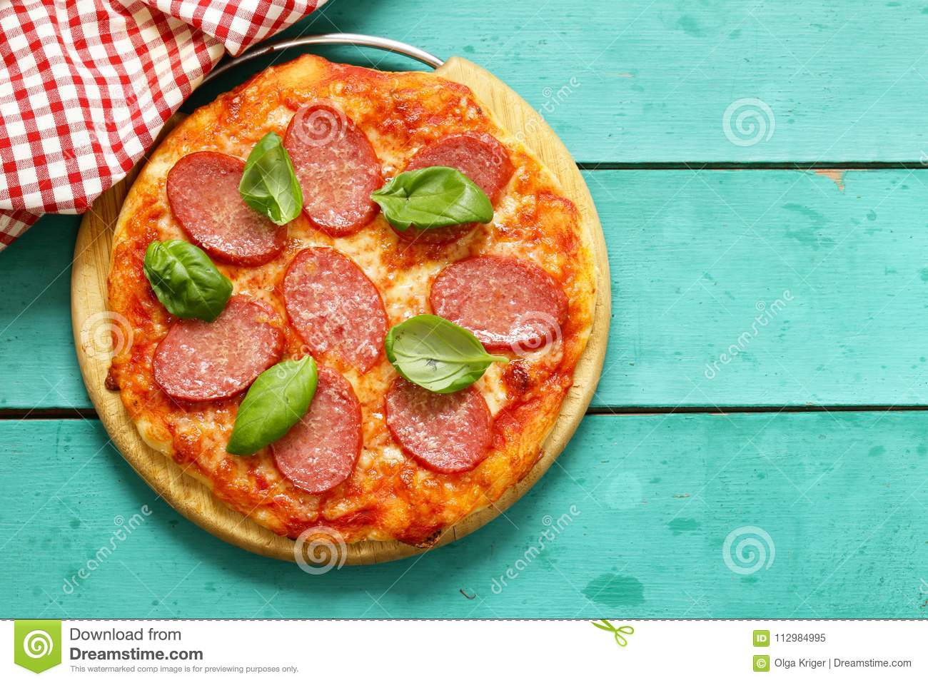 Pepperoni pizza with fresh basil