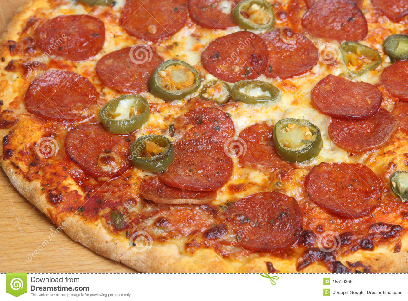 Pepperoni pizza with green chilli peppers.