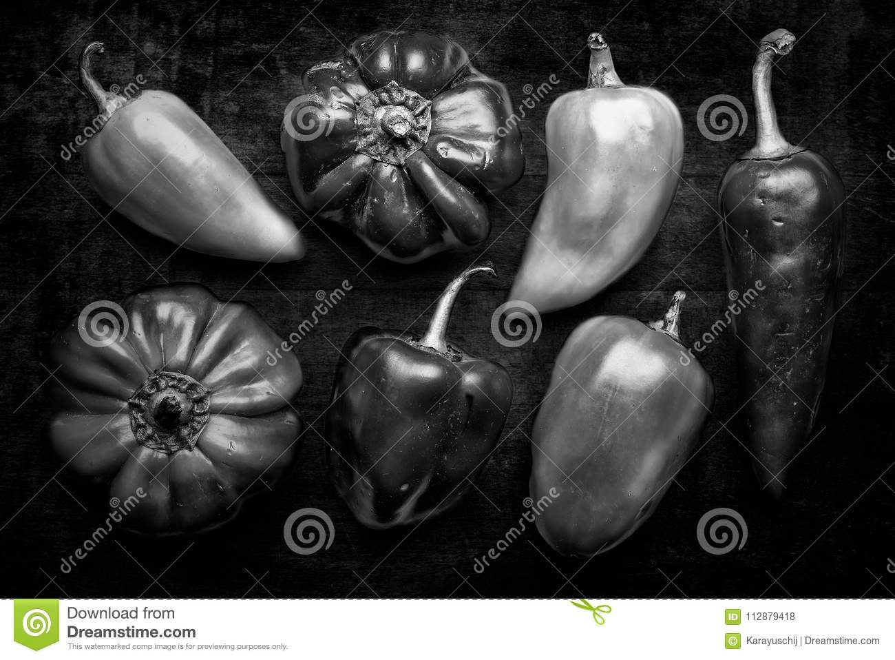 A group of natural bell peppers from the garden on a dark background