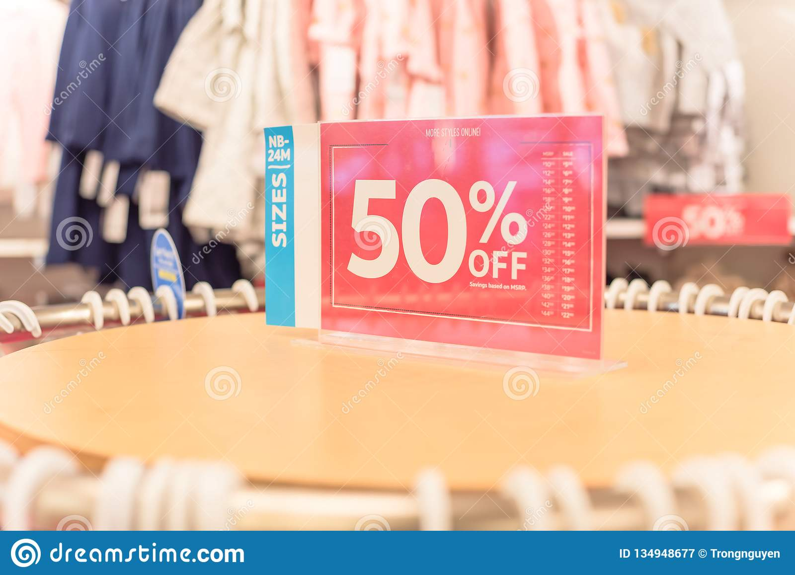 50 Percent Off Sale Sign Over Clothes At Baby Clothing ...