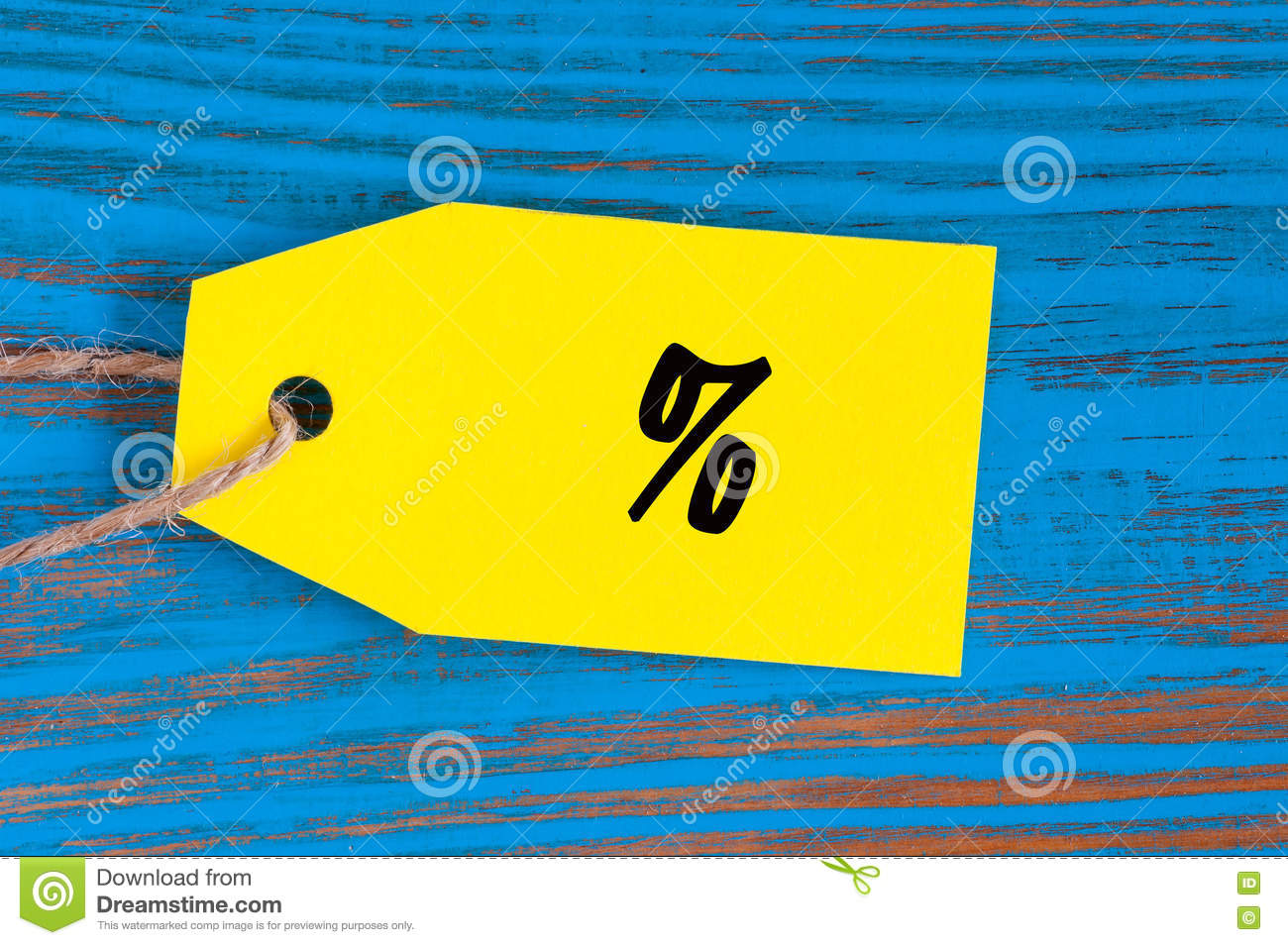 Percent Symbol Of Cloth On Yellow Tag At Blue Wooden Background