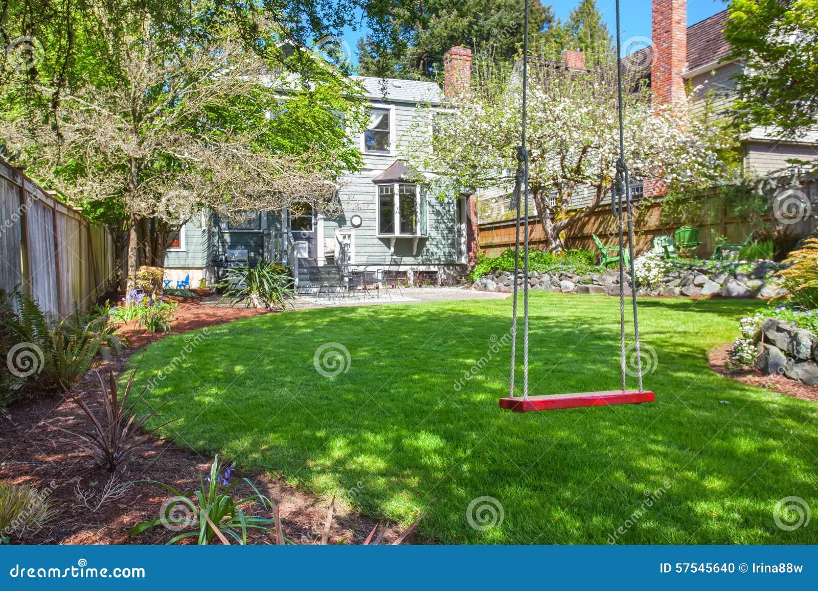 Perfect Backyard Tree : Perfect back yard with tree swing, grass, and other beautiful greenery