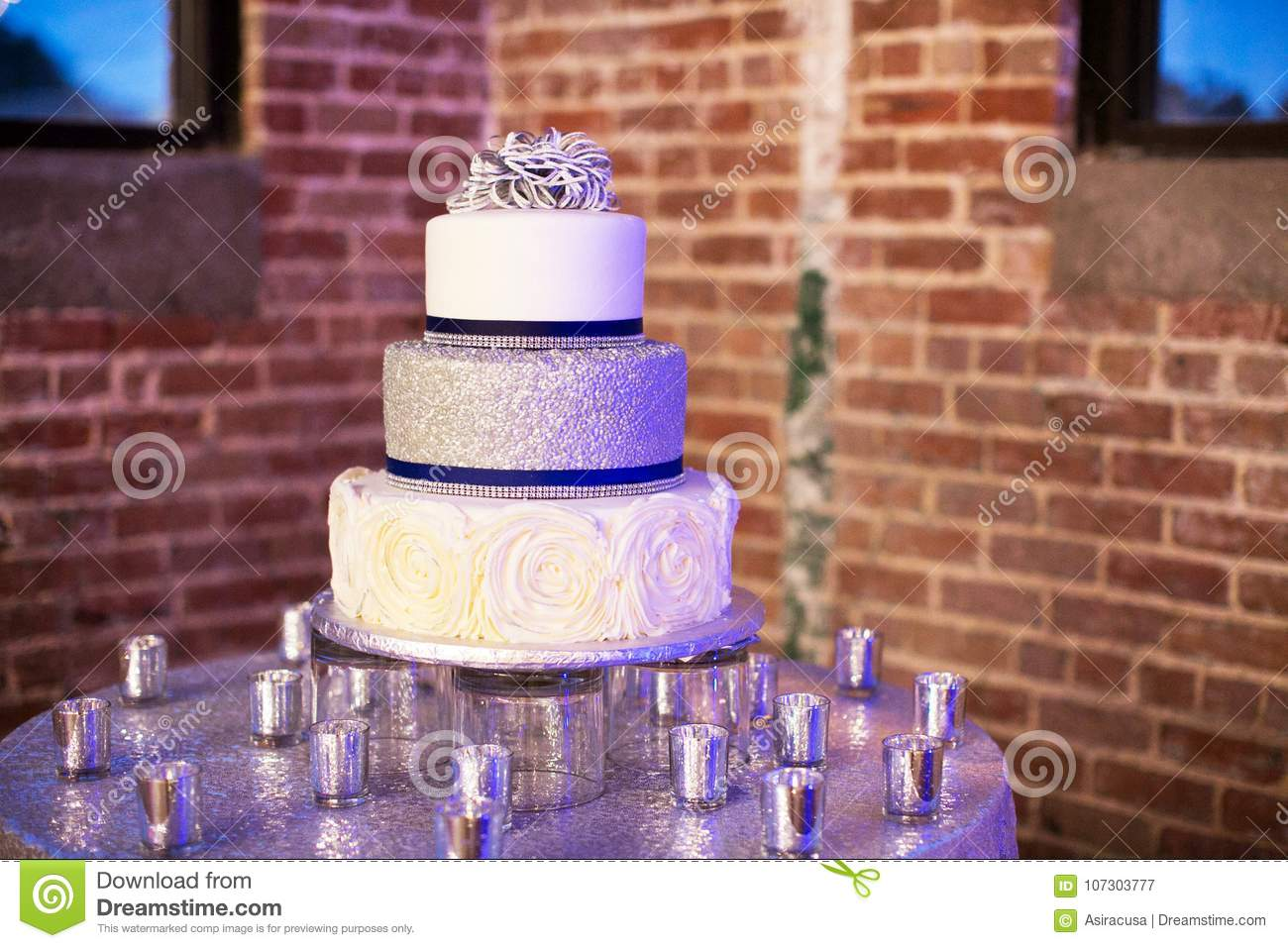Silver And Blue Wedding Cake With Candles Stock Image Image Of