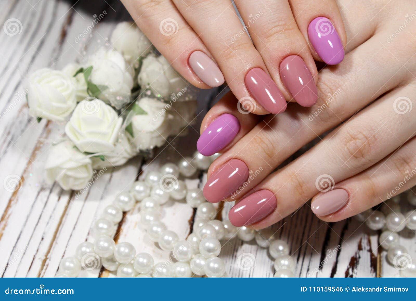 Perfect manicure and natural nails. Attractive modern nail art design. Gel  polish applied. - Perfect Manicure And Natural Nails. Stock Photo - Image Of Nail