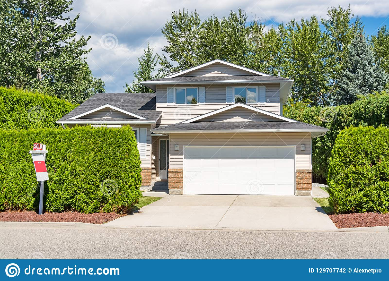 A Perfect Neighbourhood Main Entrance Of Big Residential House With Concrete Driveway And Green Hedge In Front Family House For Stock Photo Image Of Modern Front 129707742