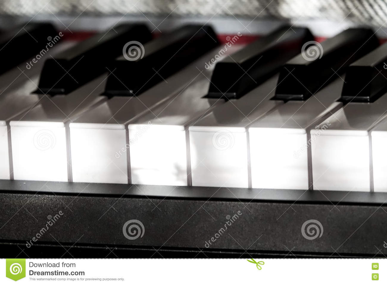 Perfect Piano keys in mild sunlight with grey cover