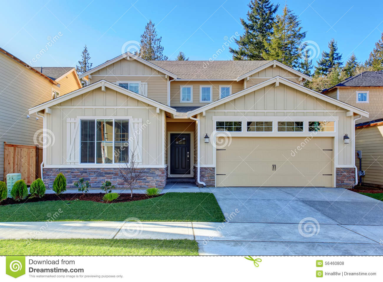 Perfect Tan Town House With Garage And Driveway Stock
