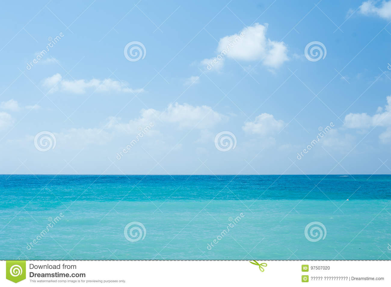 Perfect tropical white sandy beach and turquoise clear ocean water - summer vacation natural background with blue sunny sky