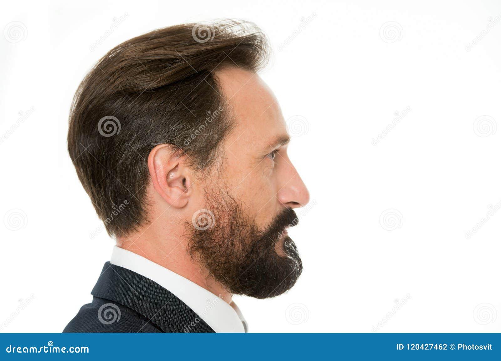 Perfecte stijl De bedrijfsmens verzorgde goed de rijpe witte achtergrond van het kerel zijaanzicht Bedrijfsmensenkapsel Zakenman