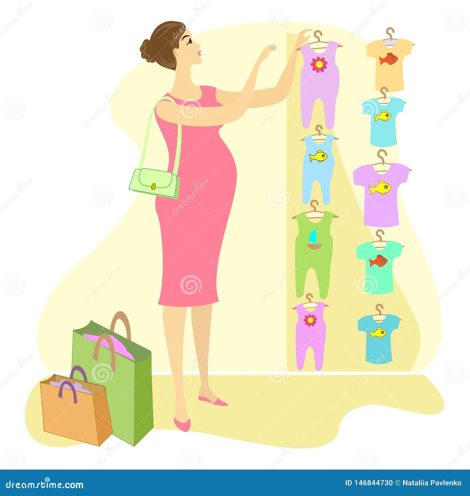 Perfil de una se?ora hermosa Una mujer embarazada, ella compra ropa para su niño Elija en los resbaladores y las camisetas de la