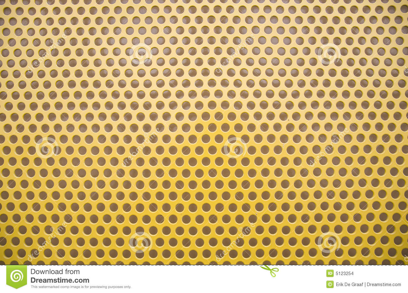 Close up of perforated yellow construction metal.
