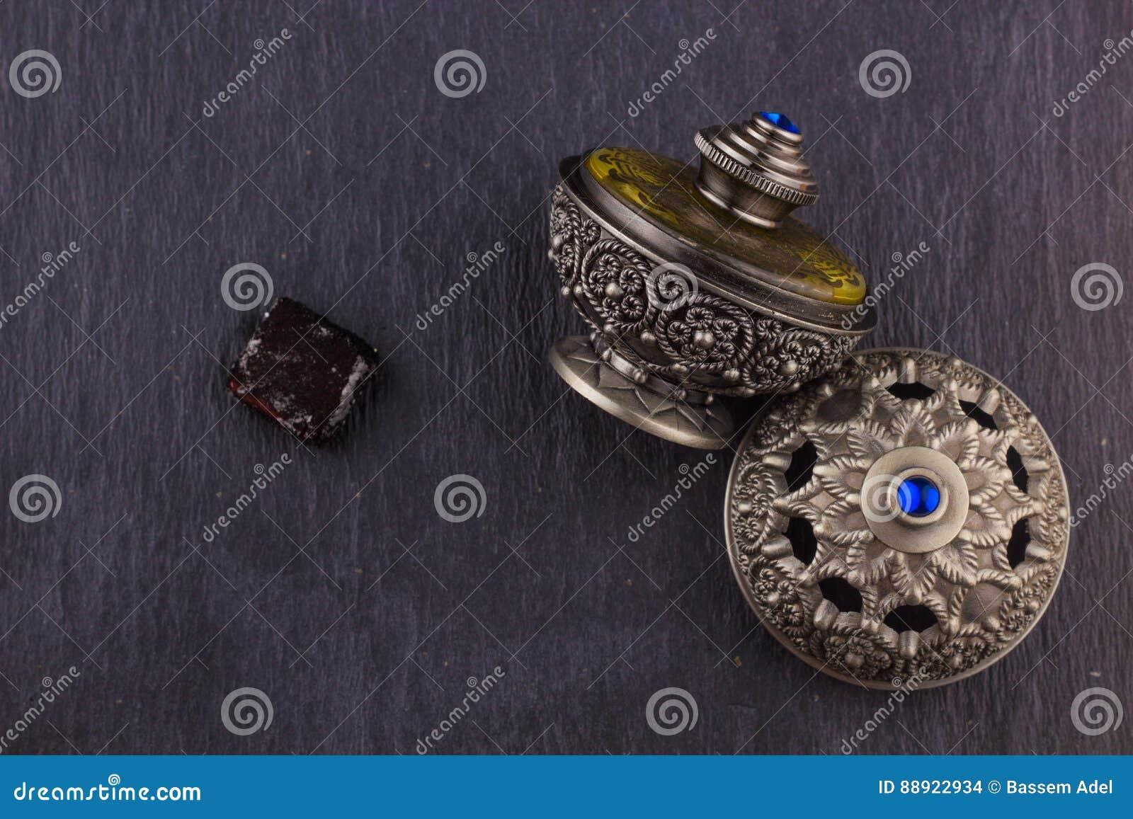 Perfume árabe artístico oriental de plata de Oud
