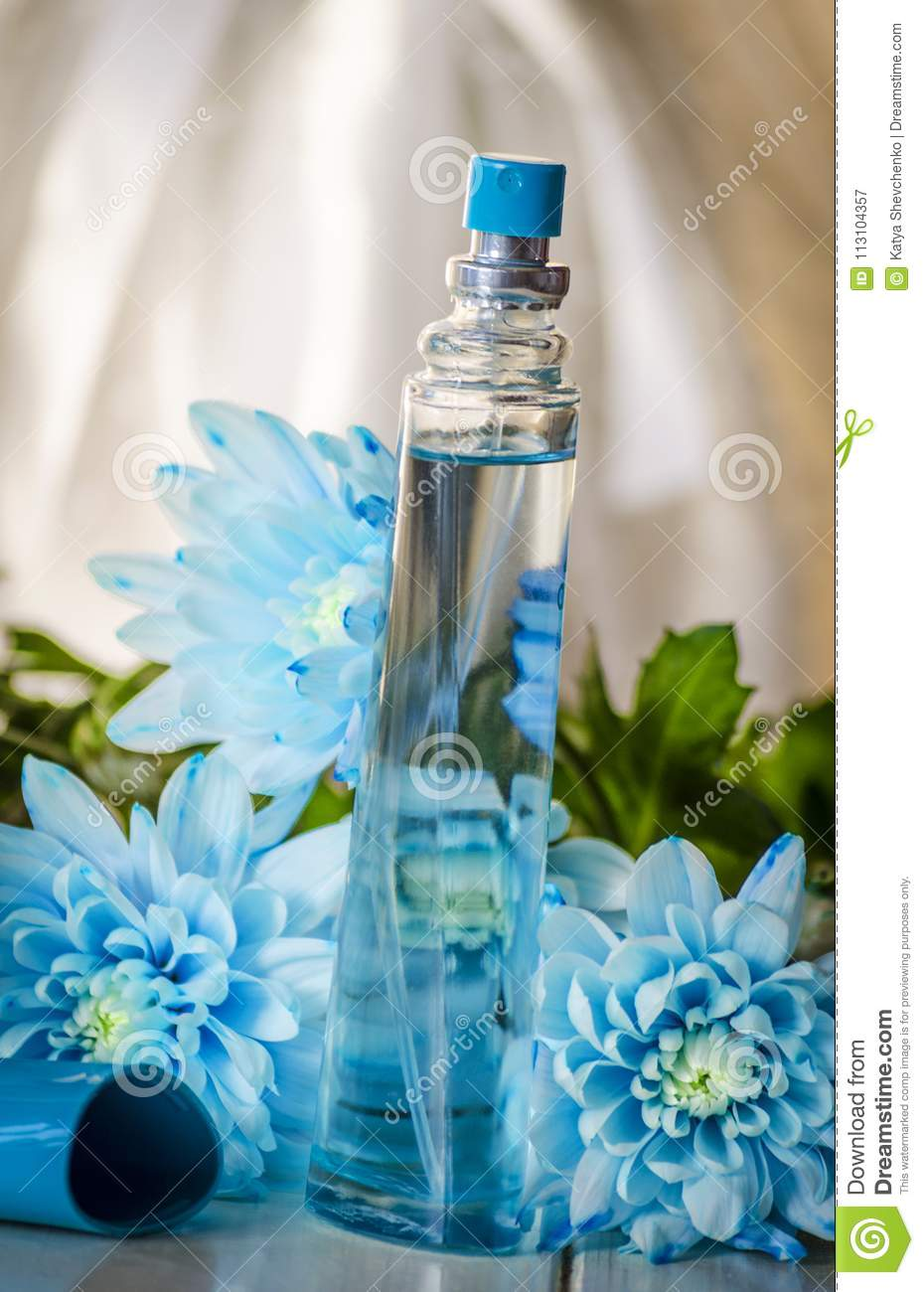 Perfume bottle on a background of flowers stock image image of download perfume bottle on a background of flowers stock image image of blue concept izmirmasajfo