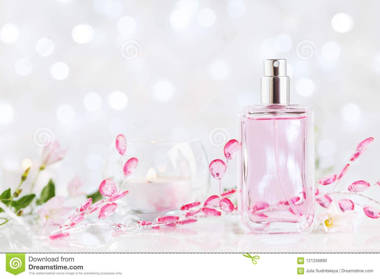 Perfume bottle with fresh flower fragrance. Beauty and perfumery background.