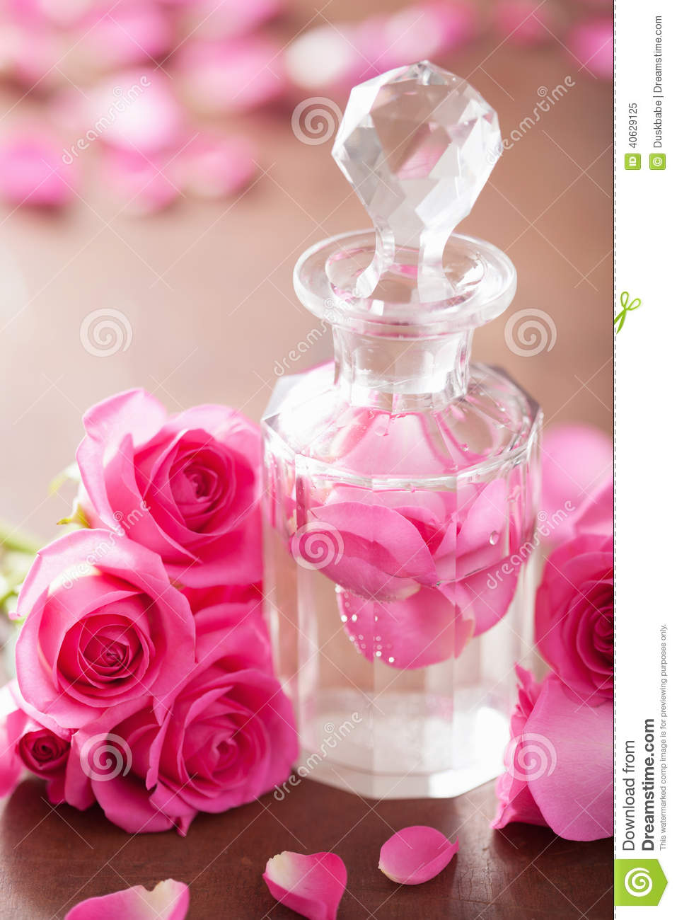 Perfume bottle and pink rose flowers spa aromatherapy stock image download comp mightylinksfo